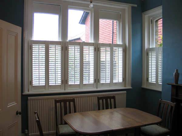Cafe height plantation shutters 47mm louvres MDF