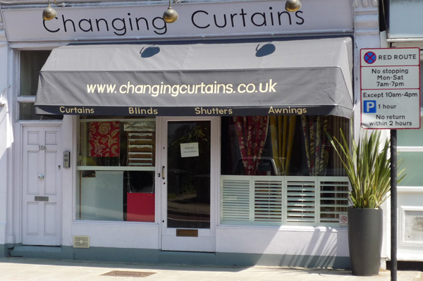 Changing curtains display of plantation shutters in north