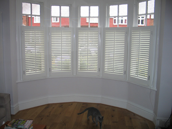 Bay window shutters - Silk White Plantation Shutters In Wood With 47mm Louvres