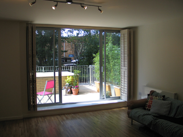 Full Height Patio Door Shutters On A Tracking System 63mm Louvres, Limed  White Stained Wood